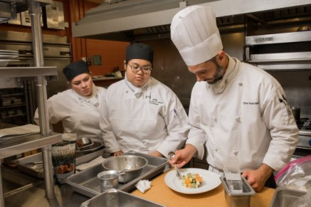 Chef Noah Miller instructs culinary arts students Jannie Mangalus and Shelby Boos during Miller's A la Carte Kitchen and Culinary Skill Development laboratories in Lucy Cuddy Hall's Bakery. (Photo by James Evans / University of Alaska Anchorage)